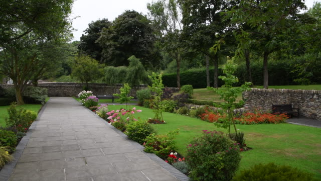 a general view of a memorial garden on the site of pantglas junior school in aberfan on august 15 2018 in merthyr tydfil united kingdom during the... - formal garden stock videos & royalty-free footage