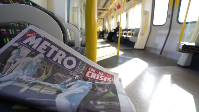 march 23: general view of a metro newspaper with a coronavirus headline on a near empty tube as the uk government tells the public to stay at home... - newspaper headline stock videos & royalty-free footage