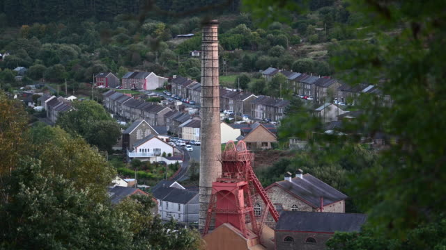 a general view of a mine shaft tower and chimney at the rhondda heritage park in the former mining community of trehafod in the rhondda valley... - mine shaft stock videos and b-roll footage