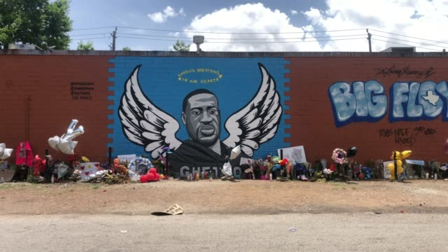 a general view of a mural dedicated to george floyd across the street from the cuney homes housing project in houston's third ward where floyd grew... - 壁画点の映像素材/bロール