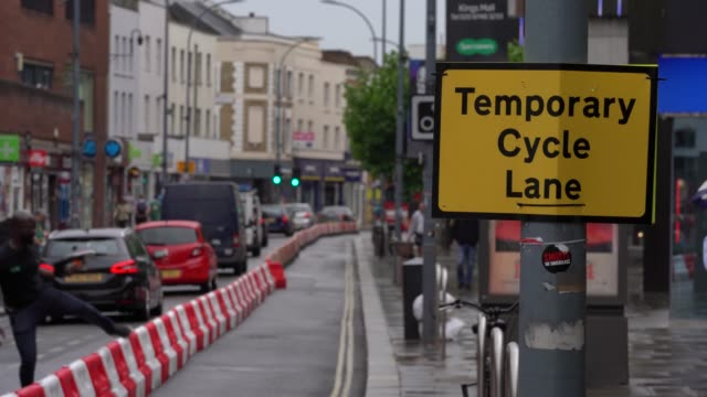 general view of a temporary cycle lane as councils implement social distancing measures in hammersmith as lockdown restrictions are eased in the uk... - temporary stock videos & royalty-free footage
