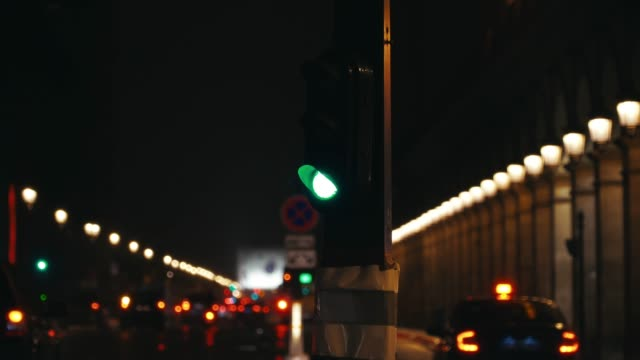 general view of a traffic light at rue de rivoli at night under the rain, on march 15, 2019 in the 1st quarter of paris, france. - traffic light stock videos & royalty-free footage