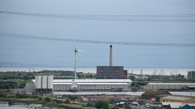 a general view of a wind turbine and power station on june 9 2019 in newport united kingdom - clear sky stock videos & royalty-free footage