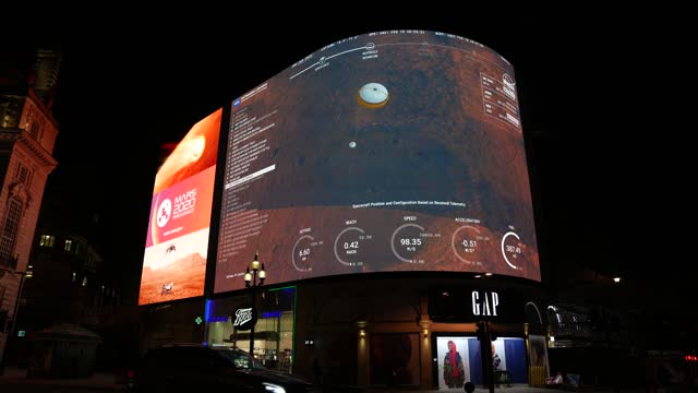 general view of advertising screens at piccadilly circus during the livesteam of the landing of nasa perseverance on mars at piccadilly circus on... - planet space stock videos & royalty-free footage