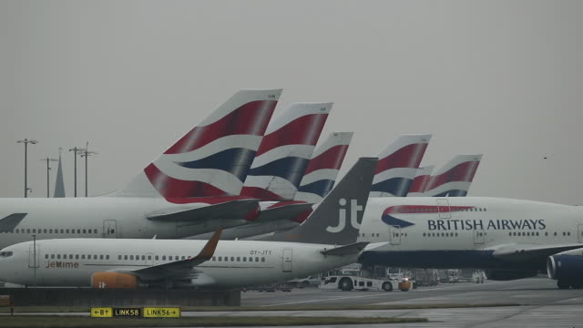 general view of airplanes being pushed back at heathrow airport on october 25, 2016 in london, england. no audio - air vehicle stock videos & royalty-free footage
