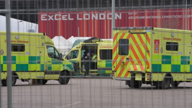 march 28: general view of ambulances outside nhs nightingale under construction at excel london as british prime minister, boris johnson, announced... - working stock videos & royalty-free footage