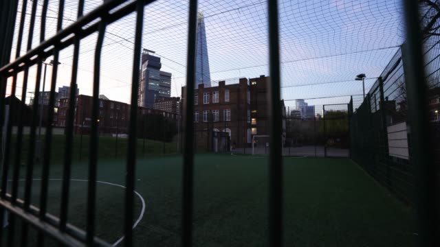 general view of an empty football pitch in bermondsey south london as british prime minister boris johnson announced strict lockdown measures urging... - pitch stock videos & royalty-free footage