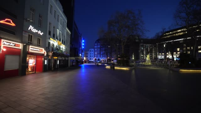 march 24: general view of an empty leicester square at night as the uk government tells the public to stay at home and avoid all non essential travel... - leicester square stock videos & royalty-free footage