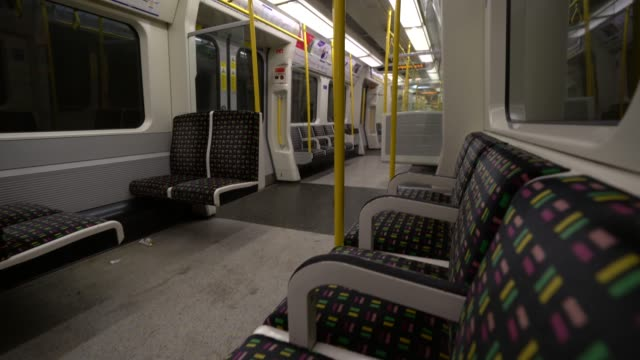 general view of an empty train carriage on the london underground as transportation hubs become quieter as the public follow government advice to... - tube stock videos & royalty-free footage