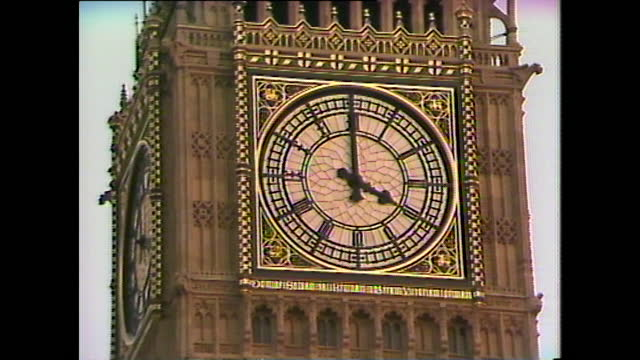general view of big ben as it makes a clunking sound rather than a chime because of ice due to the arctic freeze across the uk in january 1987. - frozen stock videos & royalty-free footage