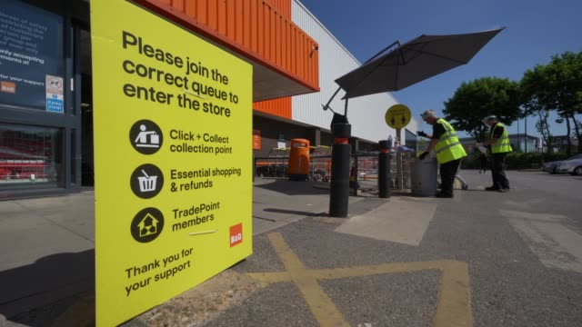 general view of b&q staff wearing ppe and a social distancing sign outside home improvement store b&q in chiswick as lockdown restrictions start to... - directional sign stock videos & royalty-free footage