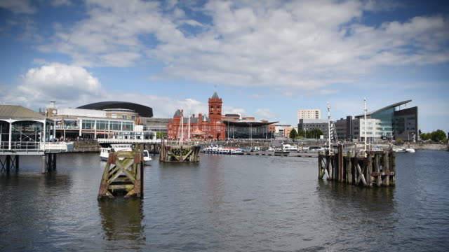 a general view of cardiff bay wales uk as a boat leaves mermaid quay on a warm summer day - cardiff wales stock videos & royalty-free footage