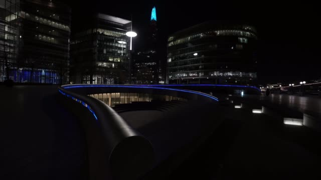 march 26: general view of city hall and the shard as uk landmarks and buildings by turning the lights blue as part of the #clapforourcarers and the... - famous place stock videos & royalty-free footage