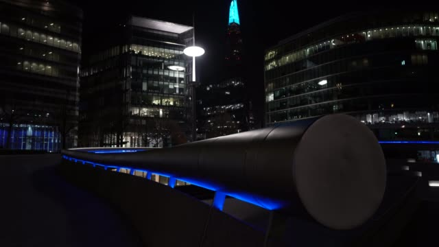 general view of city hall and the shard as uk landmarks and buildings by turning the lights blue as part of the #clapforourcarers and the... - turning stock videos & royalty-free footage