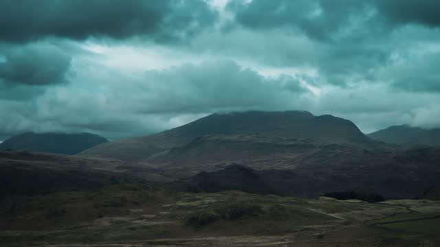 general view of clouds passing over the lake district national park on may 11, 2021 in cumbria, england. - mountain stock videos & royalty-free footage