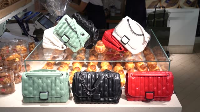 """general view of colored quilted leather bags, displayed on bun """"brioche"""" shelves, during the unveilling of the longchamp collection spring/summer... - bag stock videos & royalty-free footage"""