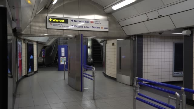 march 23: general view of empty platforms at victoria station as the uk government tells the public to stay at home and avoid all non essential... - tube stock videos & royalty-free footage