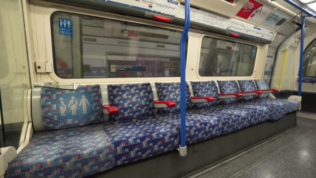 march 24: general view of empty seats on the piccadilly line train as the uk government tells the public to stay at home and avoid all non essential... - stay at home order stock videos & royalty-free footage