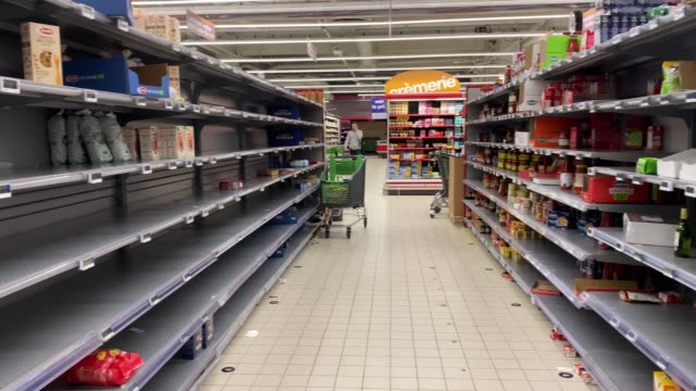 general view of empty shelves in a supermarket as people have been bulk buying due to the coronavirus covid19 outbreak on march 13 2020 in paris... - regal stock-videos und b-roll-filmmaterial