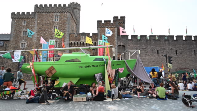 a general view of extinction rebellion protestors with a green boat on duke street outside cardiff castle as the environmental protest group ends day... - social movement stock videos & royalty-free footage