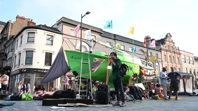 a general view of extinction rebellion protestors with a green boat on duke street outside cardiff castle as the environmental protest group ends day... - social movement stock videos and b-roll footage
