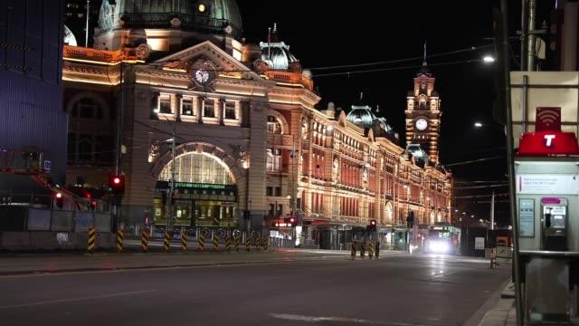 general view of flinders street station as trams travel on empty roads during curfew on september 10, 2020 in melbourne, australia. melbourne... - lockdown stock videos & royalty-free footage