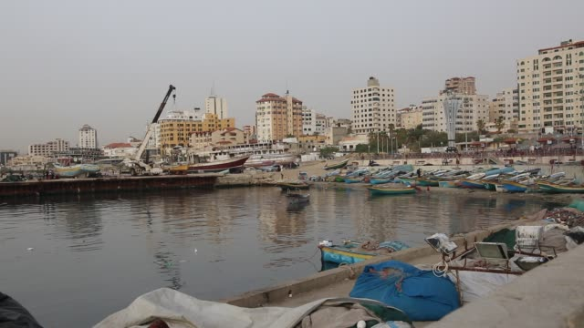 general view of gaza port during a sunset in gaza, palestine, on march 10, 2019. - ガザ市点の映像素材/bロール