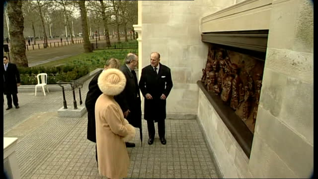 general view of guests at queen mother statue unveiling ceremony; **military band music heard intermittently over following** queen elizabeth and... - brass stock videos & royalty-free footage