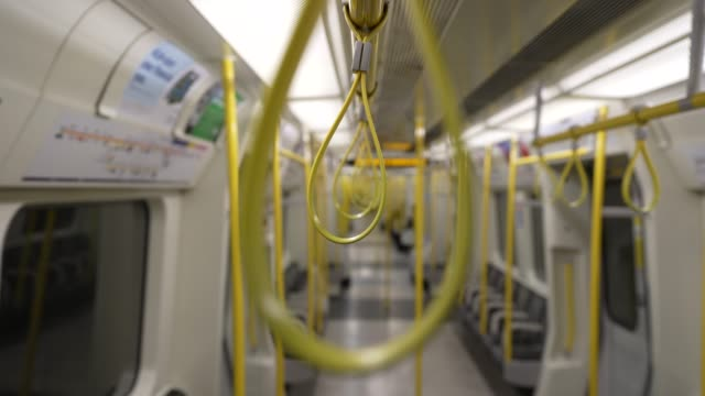 march 24: general view of handrails and empty seats on a district line train as the uk government tells the public to stay at home and avoid all non... - home economics点の映像素材/bロール