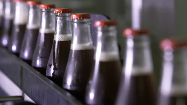 general view of karma cola bottling plant - bottling plant stock videos & royalty-free footage
