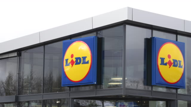 general view of lidl store signage at a lidl store in swansea, wales, uk. - general view stock videos & royalty-free footage
