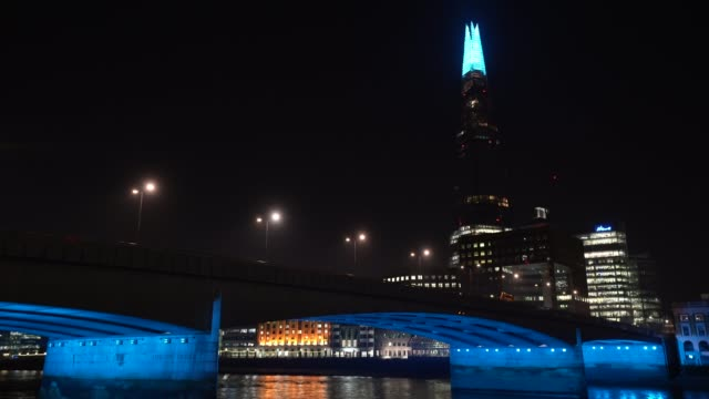 general view of london bridge as uk landmarks and buildings turn the lights blue as part of the #clapforourcarers and the #lightitbluecampaign in... - blue stock videos & royalty-free footage