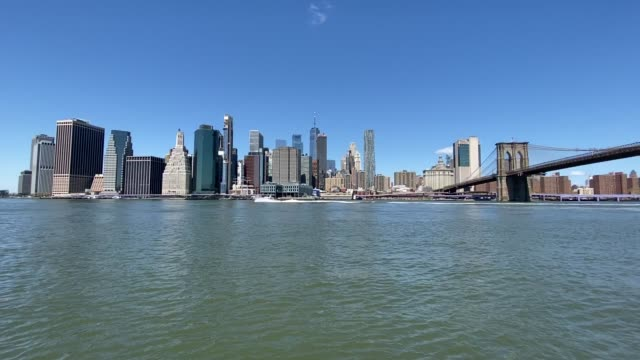 a general view of manhattan across the east river at brooklyn bridge park on in the brooklyn borough of new york city april 28 2020 the world health... - general view stock videos & royalty-free footage