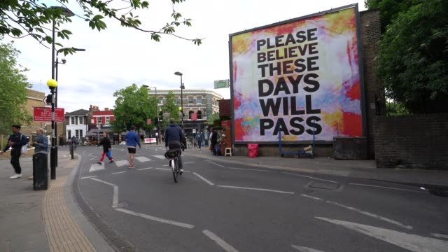 general view of members of the public in london fields, hackney practising social distancing as the uk heads into its first weekend after lockdown... - social services stock videos & royalty-free footage