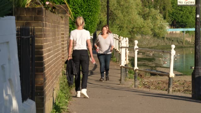 general view of members of the public navigate the narrow paths of the thames walk along the river thames as the uk heads into it's first weekend... - footpath stock videos & royalty-free footage