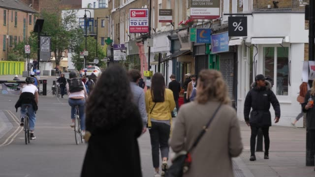 general view of members of the public using broadway market, hackney practising social distancing as the uk heads into its first weekend after... - hackney stock videos & royalty-free footage