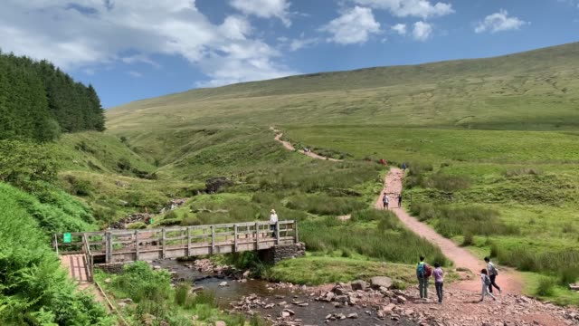 general view of members of the public walking pen y fan, south wales highest mountain on july 31, 2020 in brecon, united kingdom. high temperatures... - hiking stock videos & royalty-free footage