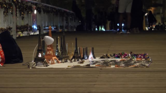 general view of miniature metallic eiffel towers at night seen on the debilly bridge on october 13 2019 in paris france - general view stock videos & royalty-free footage