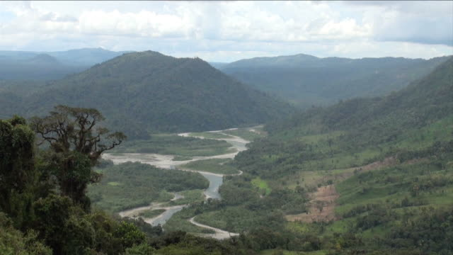 general view of mountains and river while drizzling.  - ecuador stock videos & royalty-free footage