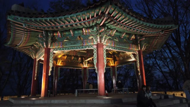 stockvideo's en b-roll-footage met general view of n seoul tower as blue lights to show support for health care workers and first responders on the front lines of the coronavirus... - number 9