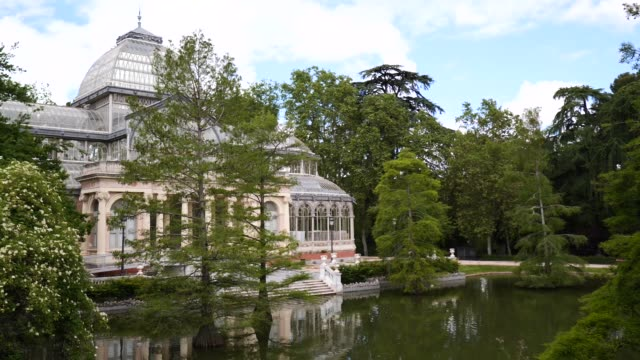 general view of palacio de cristal at the areas of the gardens of el buen retiro that remain closed since last march 14 as a prevention against the... - general view stock videos & royalty-free footage