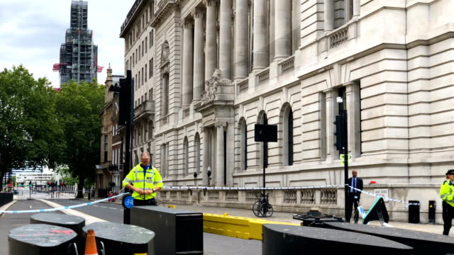 a general view of police and forensic officers at the scene where a vehicle crashed into security barriers injuring a number of pedestrians early... - ニュースコットランドヤード点の映像素材/bロール