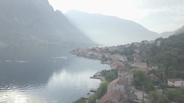 general view of prcanj town at kotor bay with st nicolas church on foreground - landscape scenery stock videos & royalty-free footage