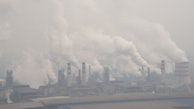 general view of qian'an steelworks on january 20, 2016 in tangshan, china. beijing is surrounded by steelworks in hebei province and most of them... - luftverschmutzung stock-videos und b-roll-filmmaterial