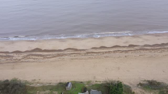 general view of sea erosion to the cliff face and sand dunes in the village of hemsby on january 27, 2021 in hemsby, england. erosion of the norfolk... - sand dune stock videos & royalty-free footage