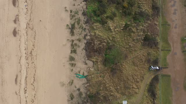 general view of sea erosion to the cliff face and sand dunes in the village of hemsby on january 27, 2021 in hemsby, england. erosion of the norfolk... - eroded stock videos & royalty-free footage