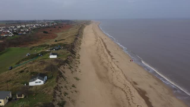 general view of sea erosion to the cliff face and sand dunes in the village of hemsby on january 27, 2021 in hemsby, england. erosion of the norfolk... - cliff stock videos & royalty-free footage