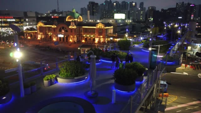 general view of seoulro as blue lights to show support for health care workers and first responders on the front lines of the coronavirus pandemic... - südkorea stock-videos und b-roll-filmmaterial