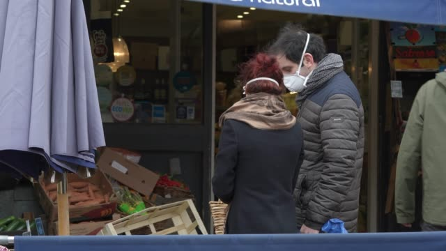 general view of shoppers practising 'social distancing' by keeping two meters apart from each other as they queue outside a shop as british prime... - queuing stock videos & royalty-free footage