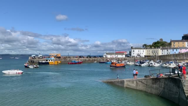a general view of tenby harbour as boats arrive and depart on july 16 2020 in tenby wales united kingdom the welsh government has announced the... - satisfaction stock videos & royalty-free footage